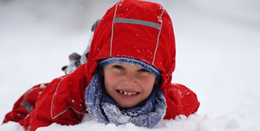 Kid playing snow
