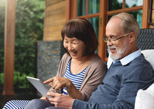 Older adult couple looking at an iPad