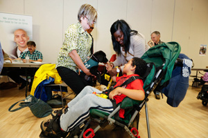 Boy in wheelchair participating in Markham's Accessibility Fair