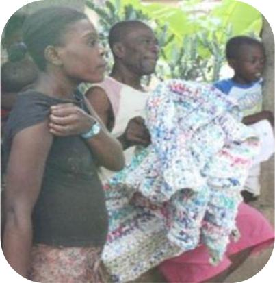 Residents in Haiti receiving sleeping mats