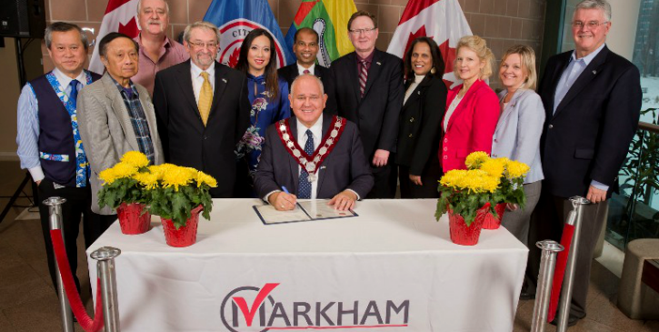 Mayor Frank Scarpitti signs the agreement on behalf of the City of Markham.